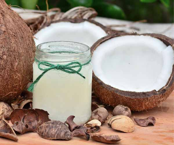 Coconut Oil -13 Natural Herbs That Can Stimulate Hair Growth